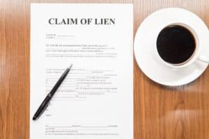 Claim of lien form on the table.