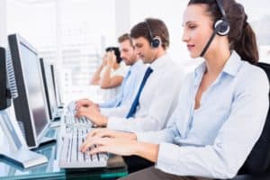 911 Call center agents taking queries.
