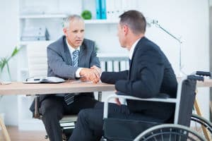 A Richmond workers' compensation lawyer shaking the hand of his client.