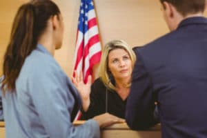 Our wrongful death attorney talking to a judge during a trial.