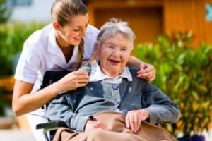Happy senior in nursing home care.
