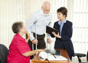 An elderly couple speak to a Richmond slip and fall lawyer.