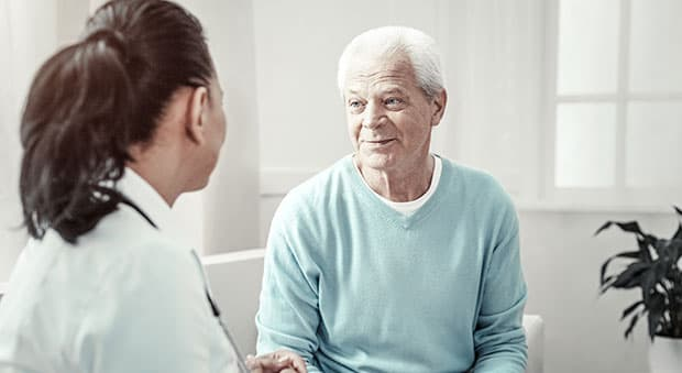 A man talking to his doctor about applying for SSD in Richmond, Virginia.